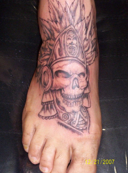 Perfect Black Color Ink Aztec Skull Tattoo On Foot For Boys