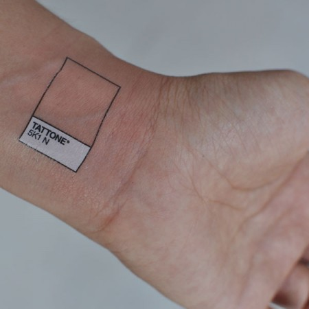 Realistic White And Black Color Ink Pantone Chip Tattoo On Wrist For Boys