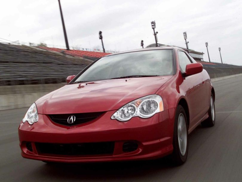 Red wonderful Acura RSX Car on the road