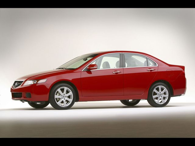 Right side of beautiful red Acura TSX car