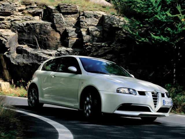 Right turn White colour Alfa Romeo 147 GTA Car on the road