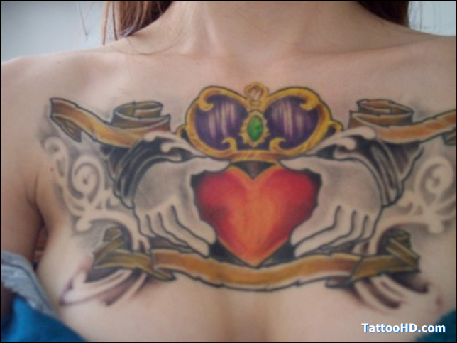 Stunning Yellow Blue Red And Black Color Ink Claddagh Tattoo On Chest For Girls
