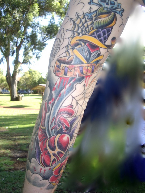 Superb Blue Yellow Red And Black Color Ink Mum Dagger Tattoo Design For Boys
