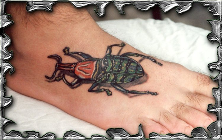 Superb Green Black And Red Color Ink Bug Tattoo Image On Foot For Boys