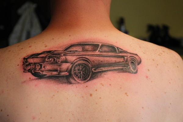 Sweet Black And Red Color Ink Car Tattoo On Upper Back For Boys