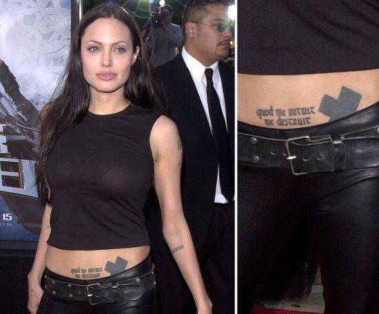 Sweet Black Color Ink Celebrity Tattoo Design On Lower Stomach For Girls