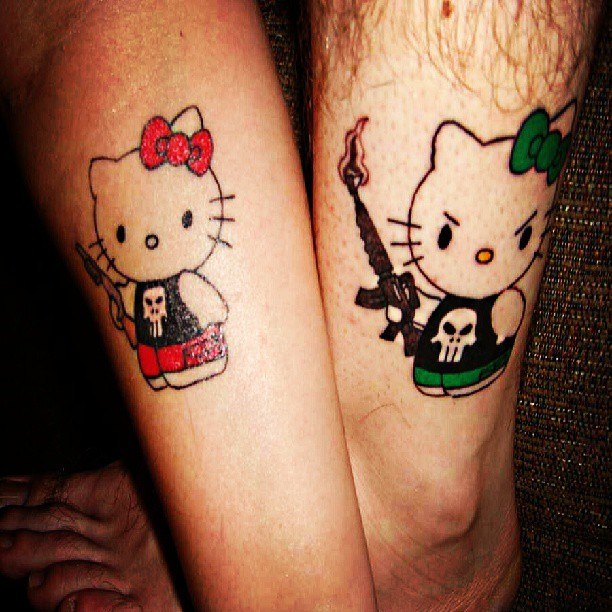 Traditional Green Red And Black Color Ink Kitty Couple Tattoo On Leg For Couple