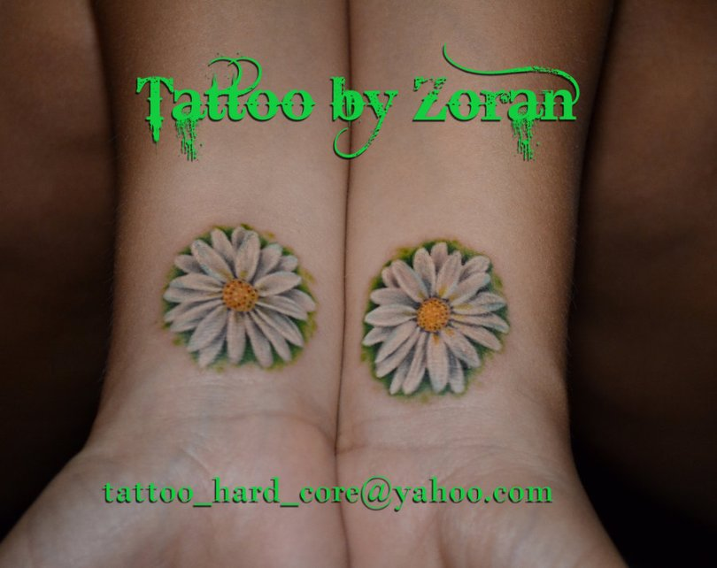 Traditional White Green And Yellow Color Ink Twin Daisy Tattoo On Wrist For Girls