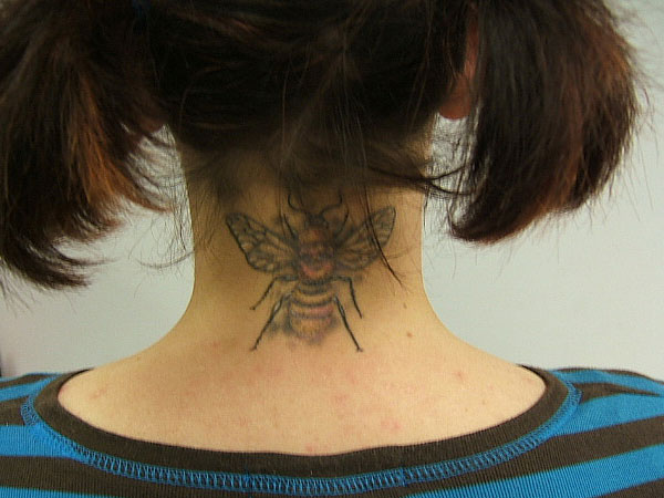 Ultimate Black And Yellow Color Ink Bumblebee Tattoo On Neck Back For Girls