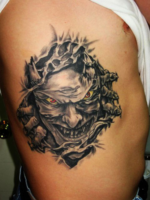 Ultimate Yellow Red And Black Color Ink Ripped Skin Demon Tattoo On Rib Side For Boys