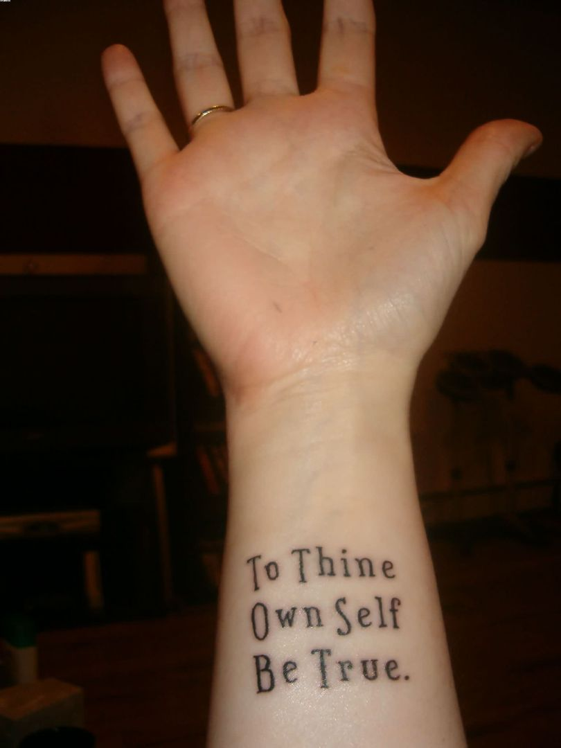 Very Nice Quote Tattoo On Wrist With Black Ink