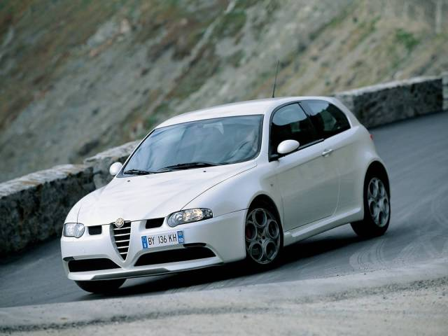 Very beautifully White colour Alfa Romeo 147 GTA Car on the road