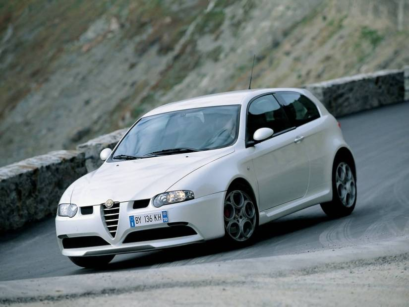 Very beautifully White colour Alfa Romeo 147 GTA Car on the road