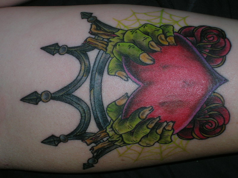Weird Green Red And Black Color Ink Zombie Claddagh Tattoo Design For Girls