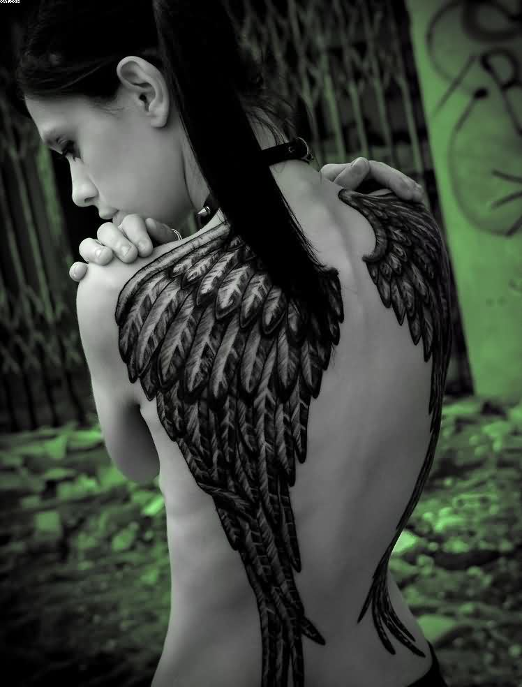 Wing Tattoo On Cute Girl's Back