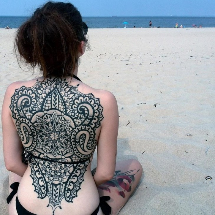 most cutest back tattoo with black ink for man and woman