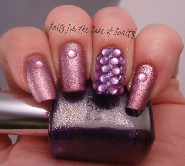 Amazing Stone With purple Color Accent Nail Art
