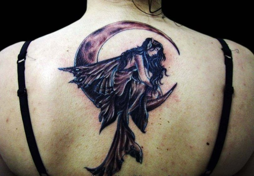 Attractive Fairy Fantasy Tattoo Picture On Upper Back For Girls