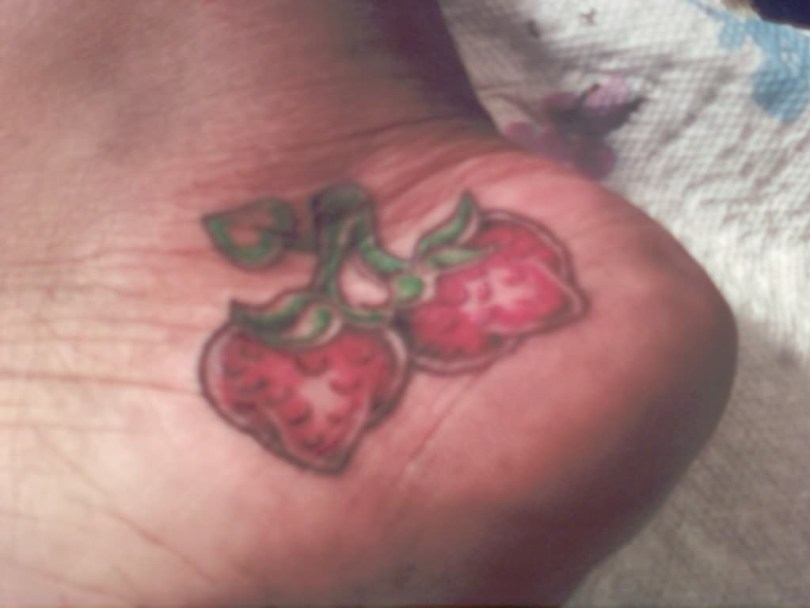 Attractive Strawberry Heel Tattoo For Boys