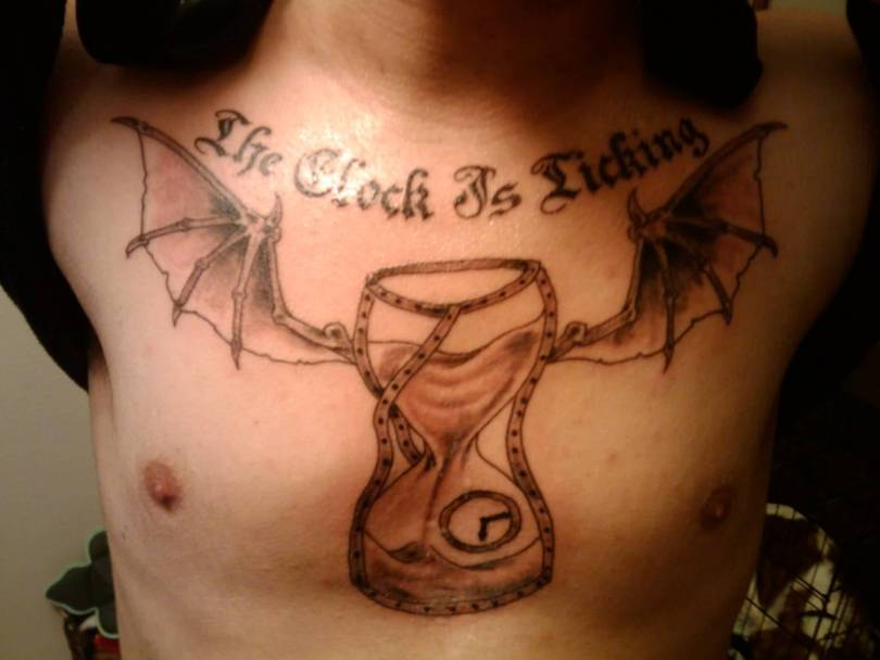 Attractive Winged Hour Glass Tattoo On Chest For Boys