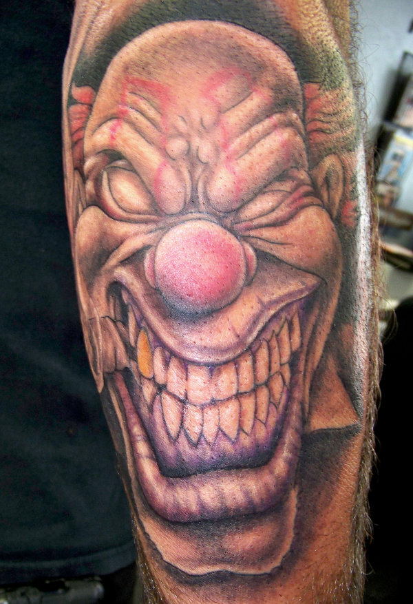 Beautiful Big Teeth Clown Head Tattoo Design For Boys