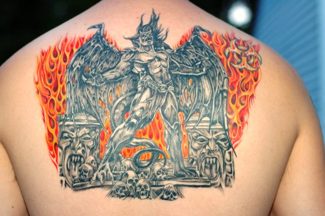 Brilliant Gargoyle n Fire Tattoo On Upper Back For Boys