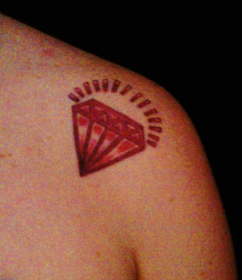 Cool Red Diamond Tattoo On Left Front Shoulder For Girls Only