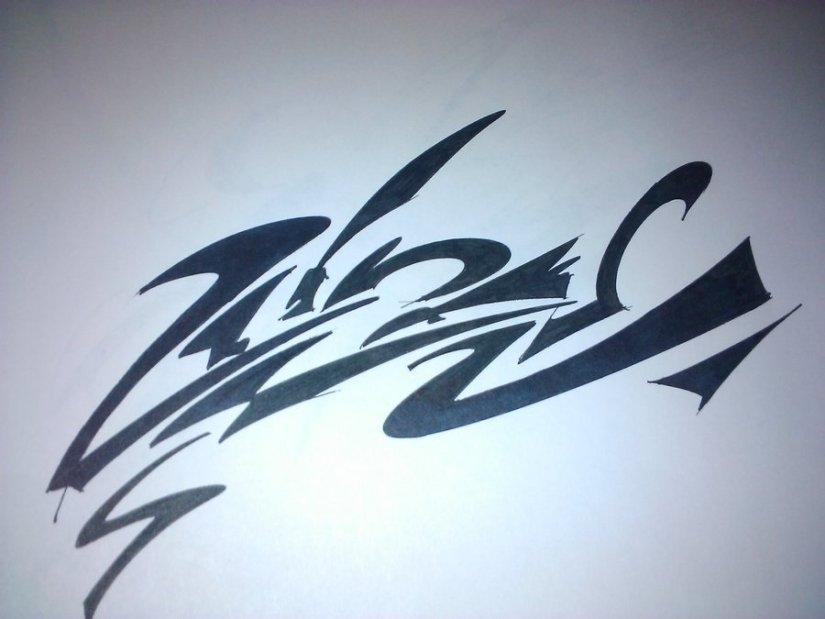 Coolest Tribal Graffiti Tattoo Design For Boys