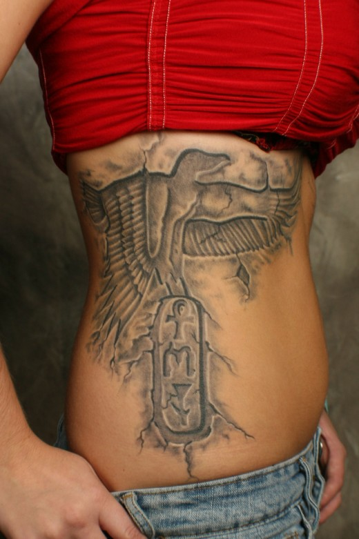 Creative Egyptian Tattoo On Ribs For Women