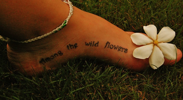 Creative Flowers Tattoo On Foot For Girls