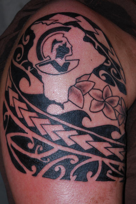 Creative Hawaiian Tattoo On Biceps For Boys