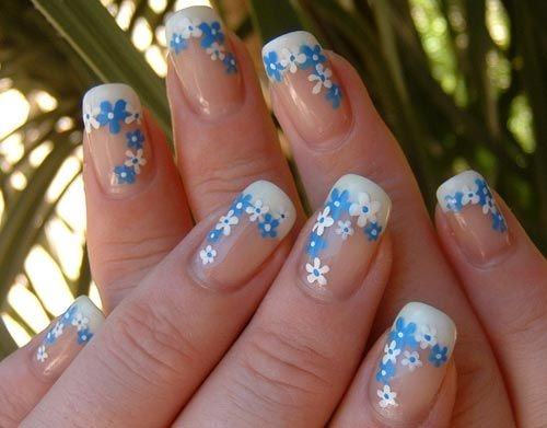 Dashing Blue Nails With Flower Design