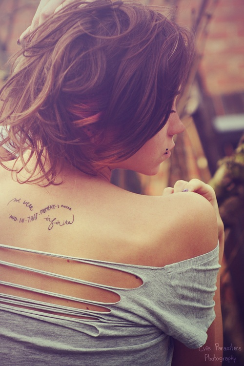 Elegant Feminine Infinity Tattoo On Upper Back For Girls