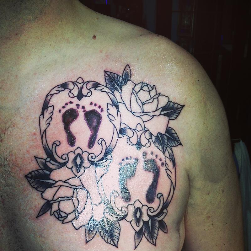 Extremely Footprints n Roses Tattoo On Chest For Boys