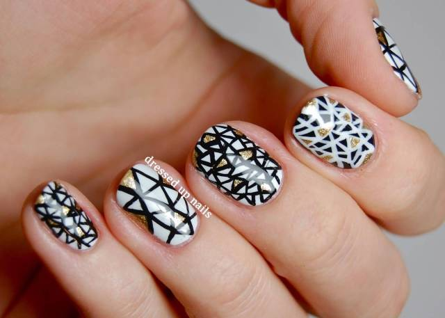 Fabulous Black And White Nails With Golden Shading