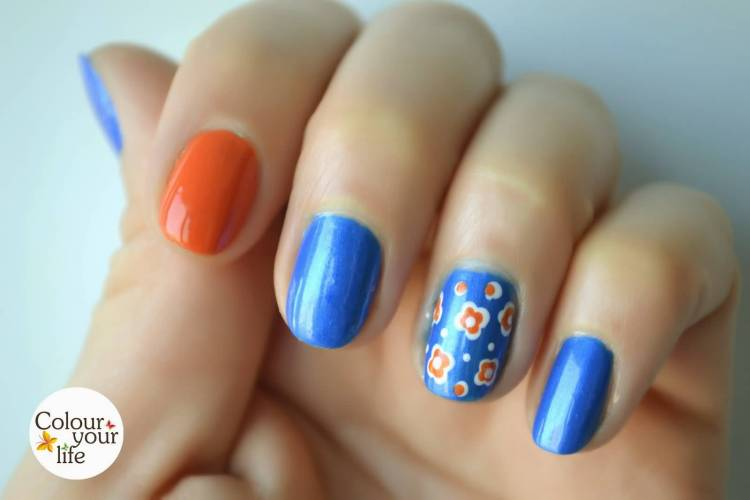 Fabulous Orange And Blue Paint With Flower Accent Nail Art
