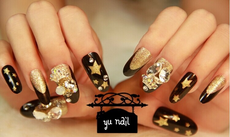Fabulous Stiletto Nails With Golden Stars Design