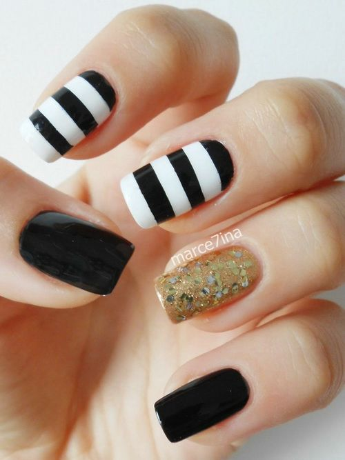 Fabulous Stripes Of Black And White Nail Art With Golden Color