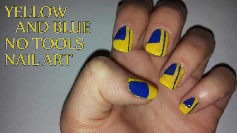 Fabulous Yellow And Blue Nails With Simple Line