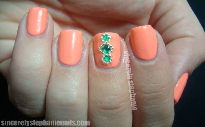 Glossy Orange Paint With Ruby 3d Accent Nail Art