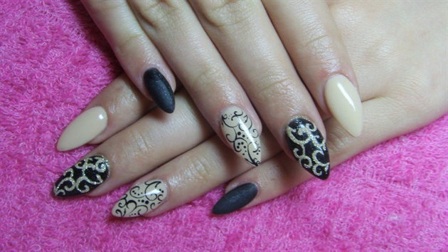 Greatest Stiletto Nails With Sparkling Nail Paint Design