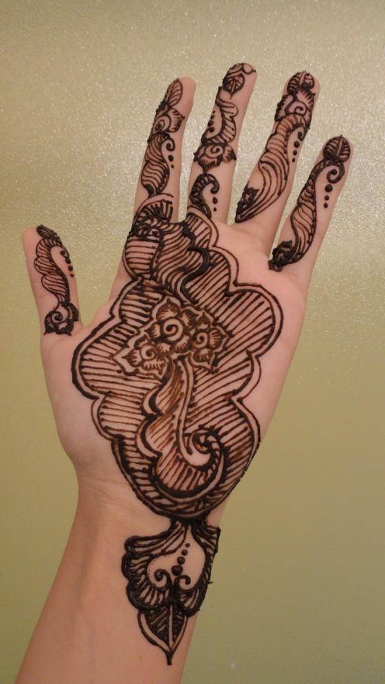 Groovy Fish Bones Henna Tattoo On Hand For Girls