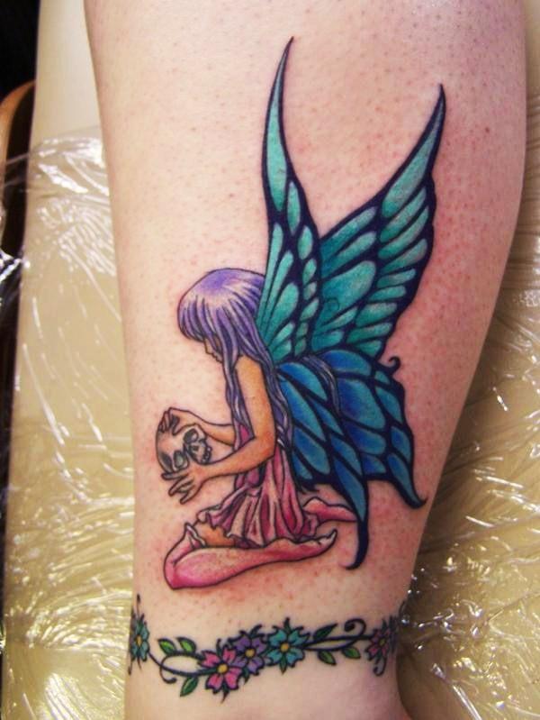 Horrible Fairy Holding Skull Tattoo Design For Girls