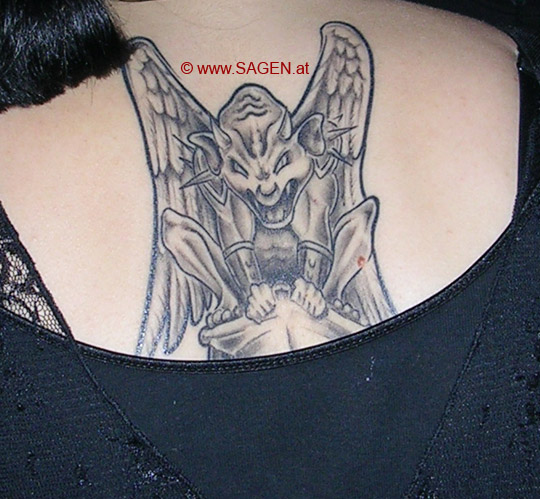 Innovative Gargoyle Tattoo On Back For Girls