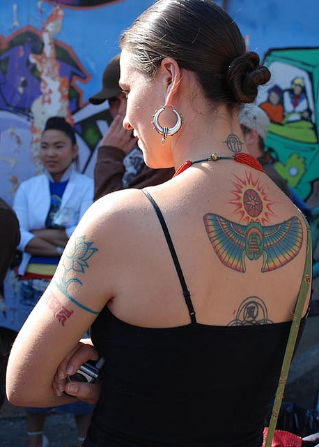 Lovely Egyptian Tattoo On Upper Back For Girls