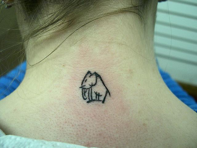 Maori Elephant Tattoo On Nape For Girls