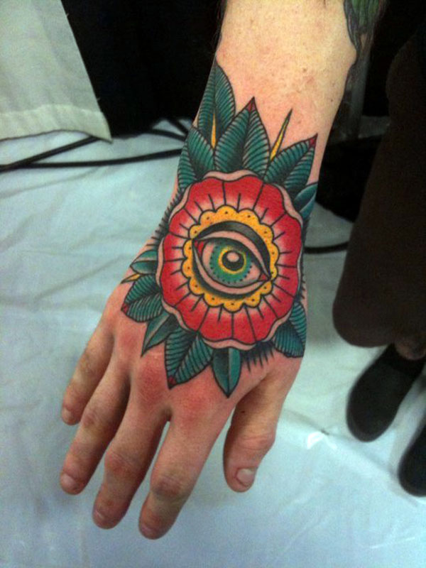 Maori Eye Flower Tattoo On Hand For Boys