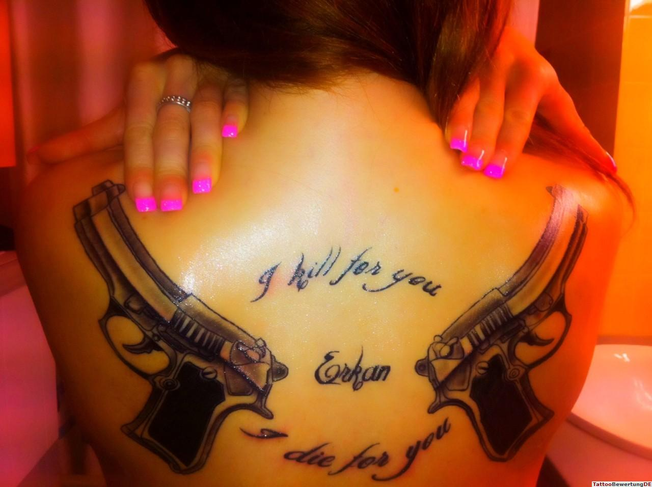 Most Beautiful  Guns Tattoo On Back For Women