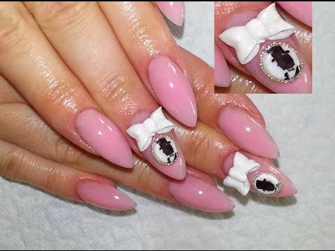 Most Cutest White And Pink Color Design On Almond Shaped Acrylic Nail Art