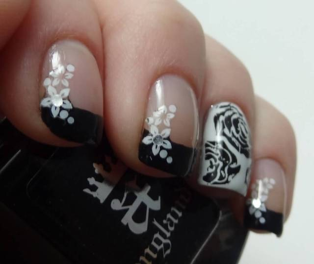 Most Trending Black Nail Art With White Color Flower